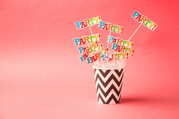 Paper glass party on a pink . beach cheers celebration