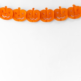 Paper halloween garland on white wall