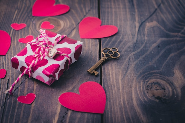 Paper heart and gift box on the old wood table background. valentine's day concept