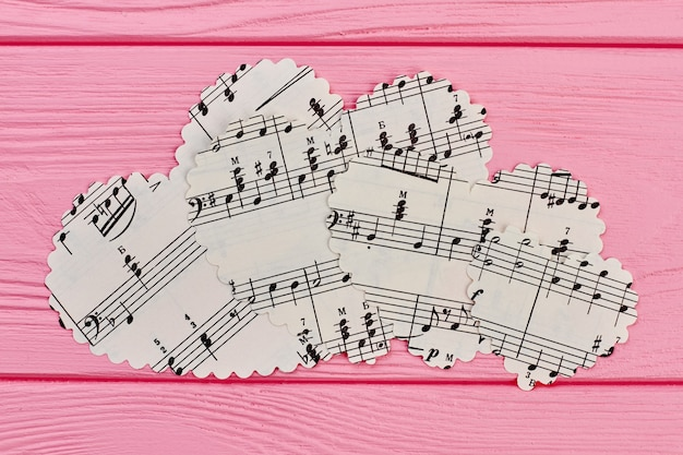 Paper heart shaped figurines with music notes.
