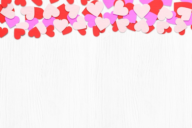 Paper heart over white wood background. with copy space. valentines day concepts.