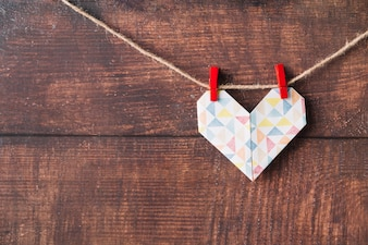 Paper heart with pins hitching on thread