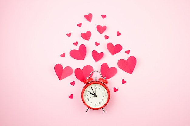 Paper hearts and alarm clock.