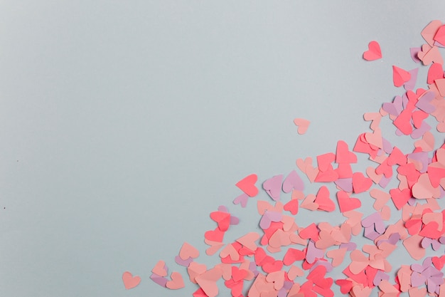 Paper hearts scattered diagonally