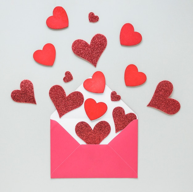 Paper hearts scattered from envelope