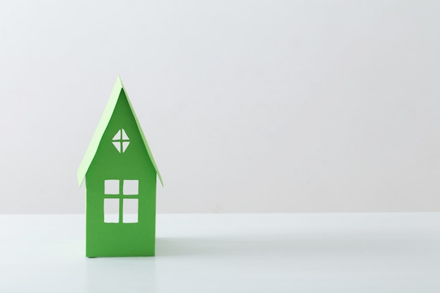 Paper house on white table