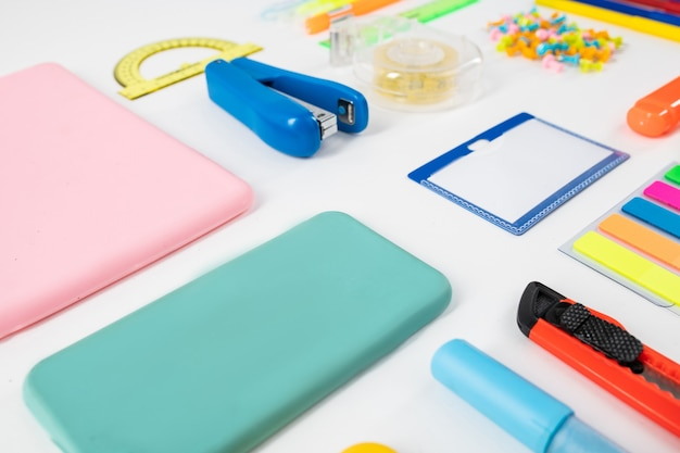 Paper knife. phone cases and stationary things placed on the floor in accurate order