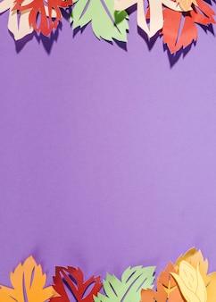 Paper leaflets on purple background