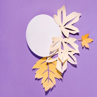 Paper leaflets with circle on purple background