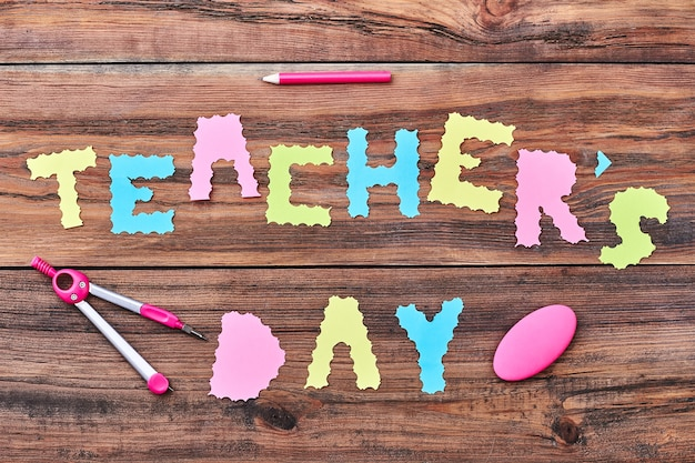 Paper letters, pencil, eraser. teacher's day is autumn holiday.