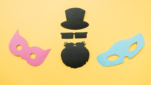 Paper mockup of masks and bearded man