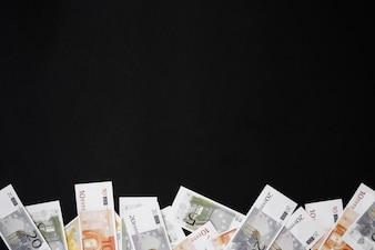 Paper money on black table