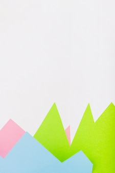 Paper mountains on white background