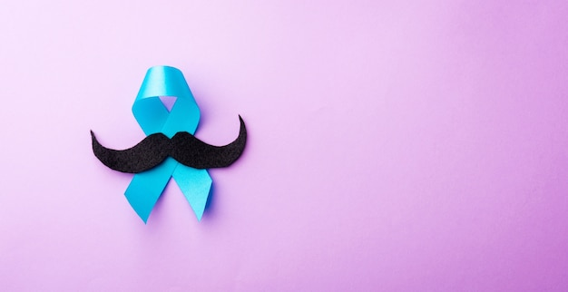 Paper mustache and light blue ribbon
