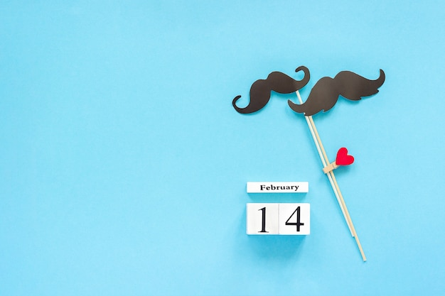 Paper mustache props and calendar february 14. concept homosexuality gay love.