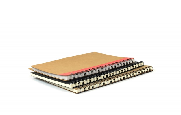 Paper note books ridge with coil on white