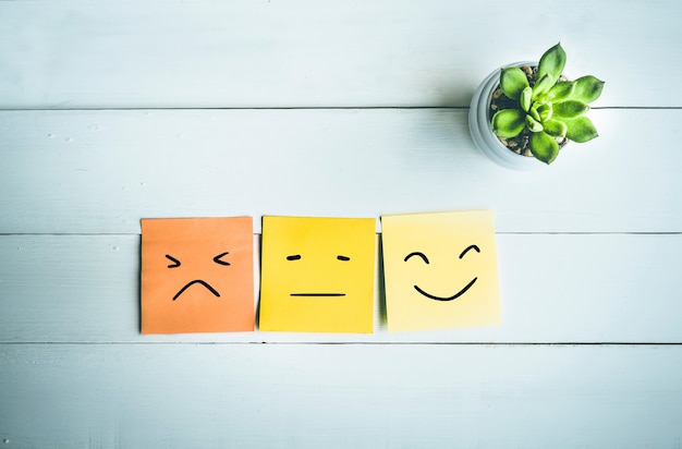 Paper note with emoticon face ideas