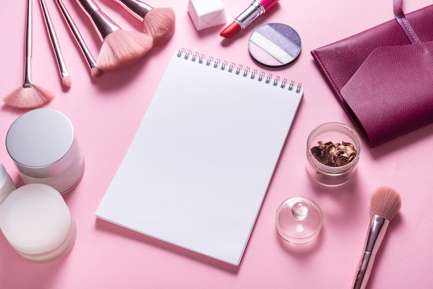 Paper notebook flat lay mock up on pink cosmetic table