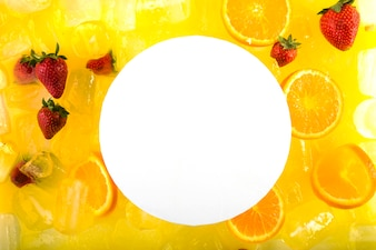 Paper on cocktail with strawberries and oranges