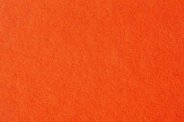 Бумажный оранжевый абстрактный фон. фотография высокого разрешения.