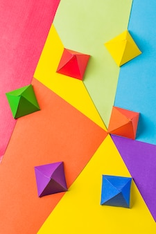 Paper origami pyramids in bright lgbt colors
