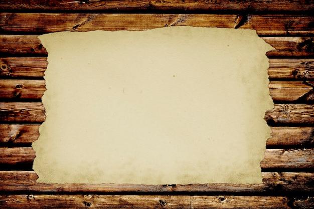 紙のページノート。木の背景に分離されたテクスチャ。 Premium写真