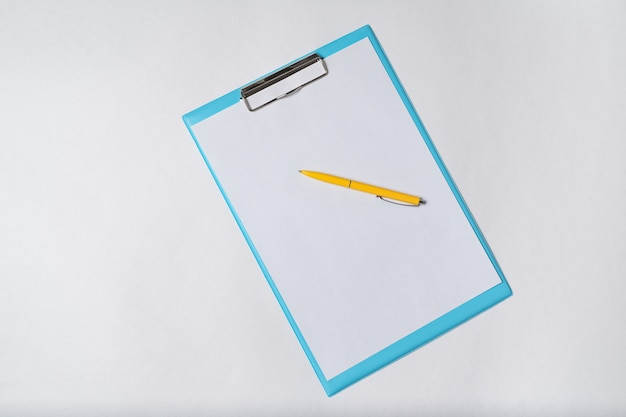 Paper and pen on white background. documents top view, copy space, backdrop pattern