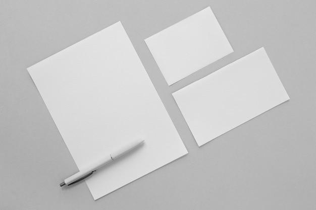 Paper pieces arrangement with pen