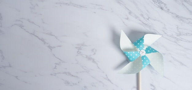 Paper pinwheel on a marble table