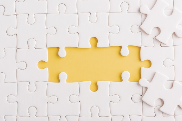 Paper plain white jigsaw puzzle game texture incomplete or missing piece