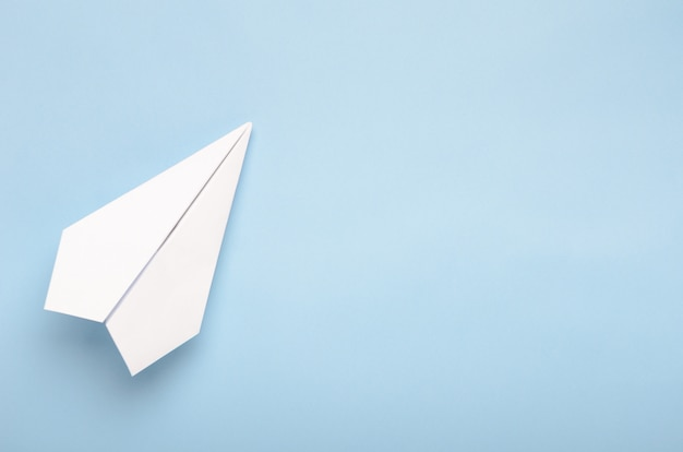 Paper plane on a blue background
