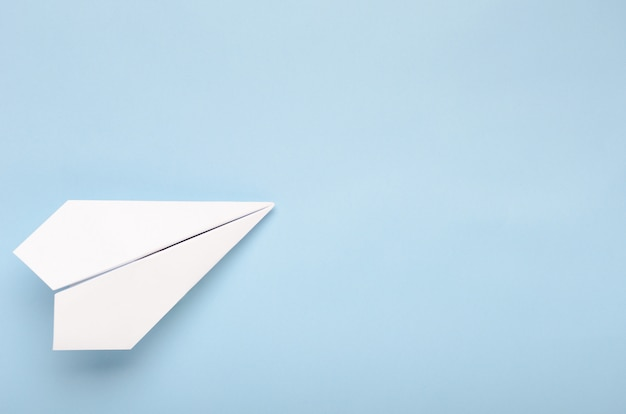 Paper plane on a blue background.