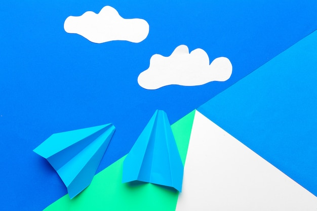 Paper plane  on a blue  with clouds