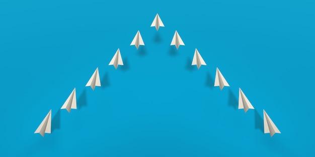 青い背景の上を飛んでいる紙飛行機の艦隊。 3dイラスト。