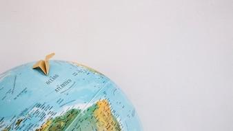 Paper plane on globe