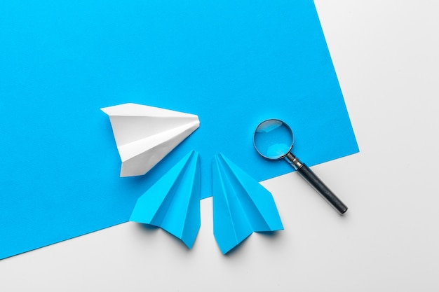 Paper plane with office supplies