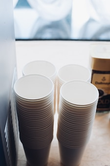 Paper or plastic cup for coffee or tea.