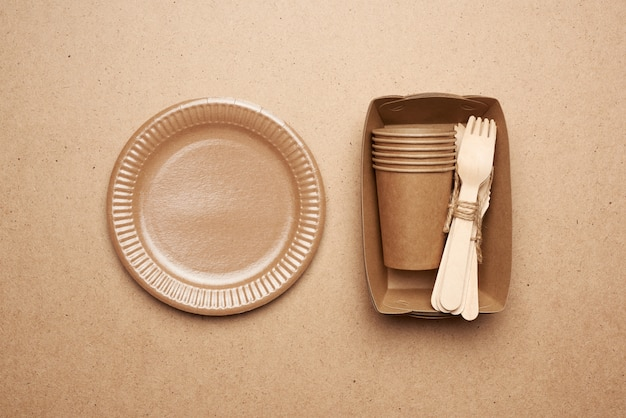 Paper plates and cups from brown craft paper and wooden forks