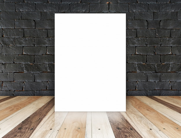 Paper poster on the black brick wall and tropical wood floor,template for your content