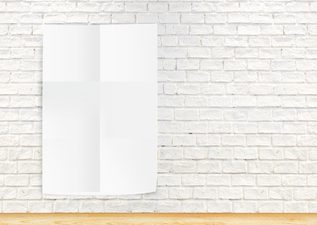 Paper poster hanging the white  brick wall and the wood floor