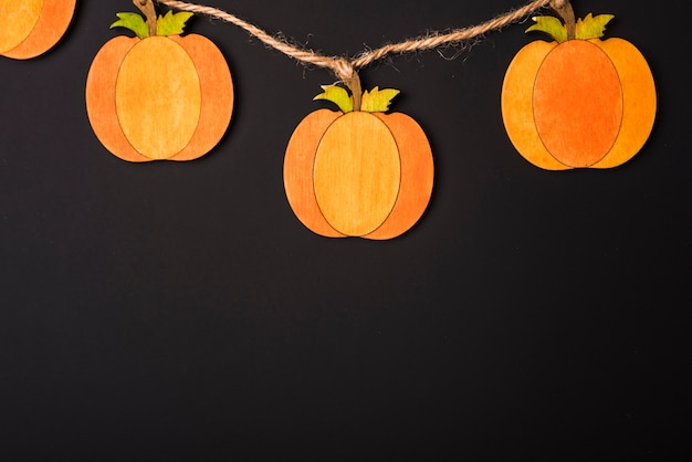 Paper pumpkins on rope