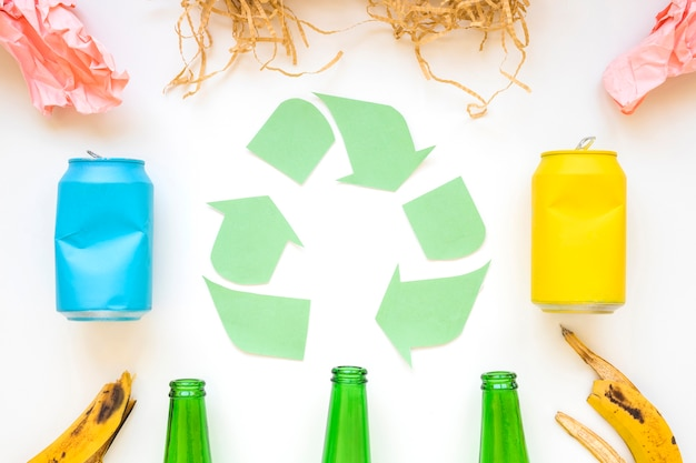 Paper recycle logo with colorful garbage