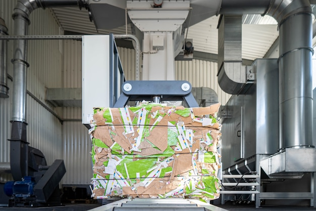 Paper recycling truck and forklift loading old papers reuse