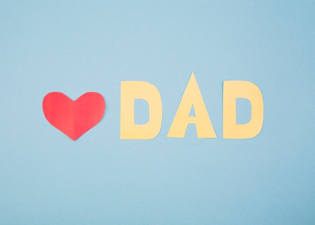 Paper red heart and dad title