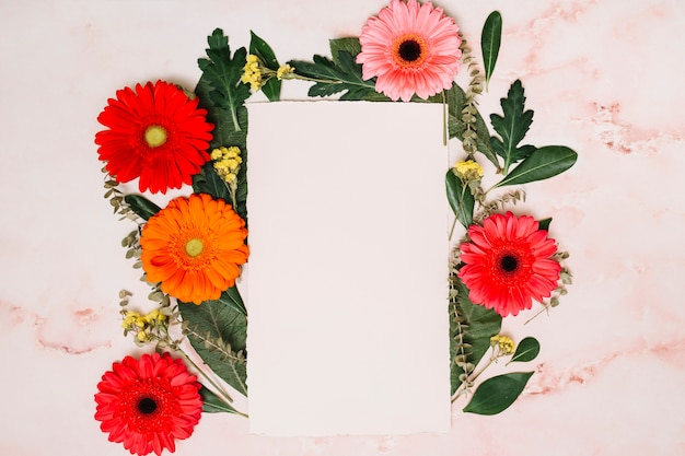 Paper sheet with bright flowers on table