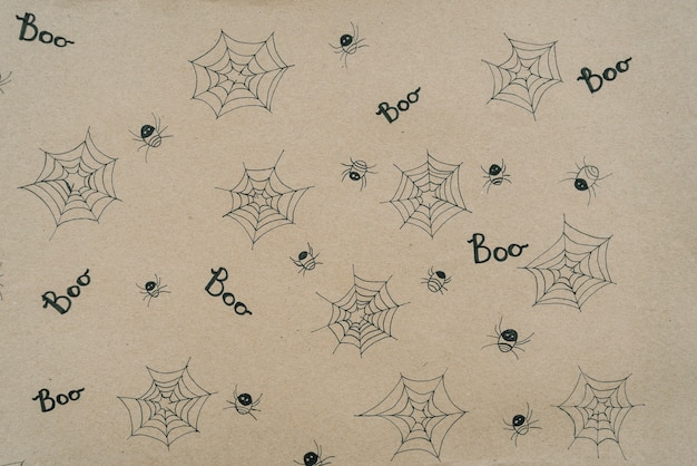Paper sheet with little spiders and tiny webs