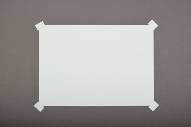 Paper sheet with sticker isolated on grey background