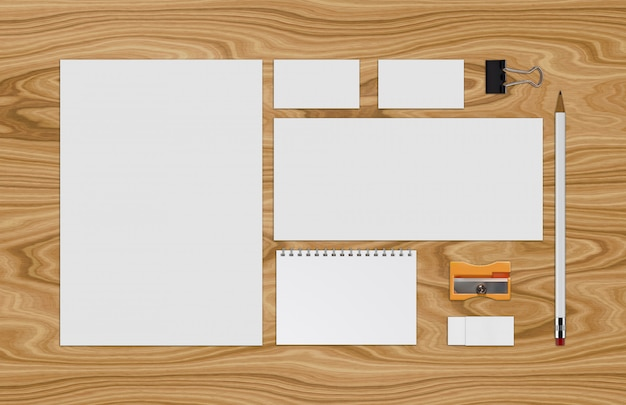 Paper sheets and pencil on wooden table