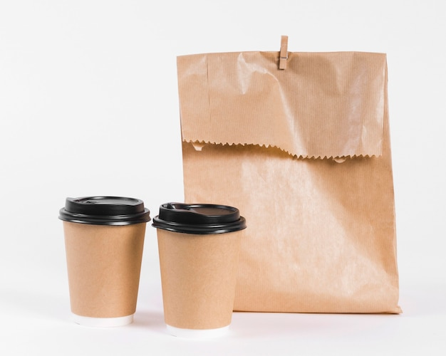 Paper shopping bag and coffee to go cups