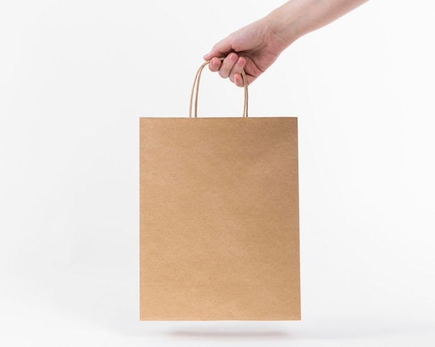 Paper shopping bag held by hand
